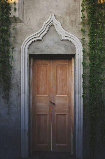Closed Wooden Door Of Historic Building
