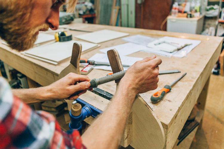 Manual worker working in carpentry workshop