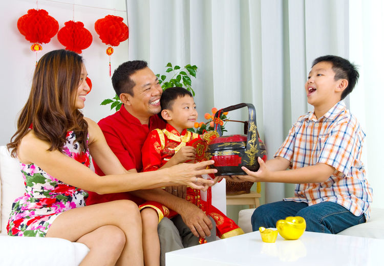 Happy family enjoying at home during festival
