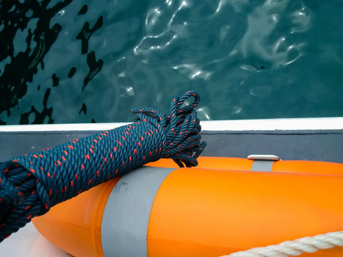Close-Up Of Inflatable Float And Rope Over Sea
