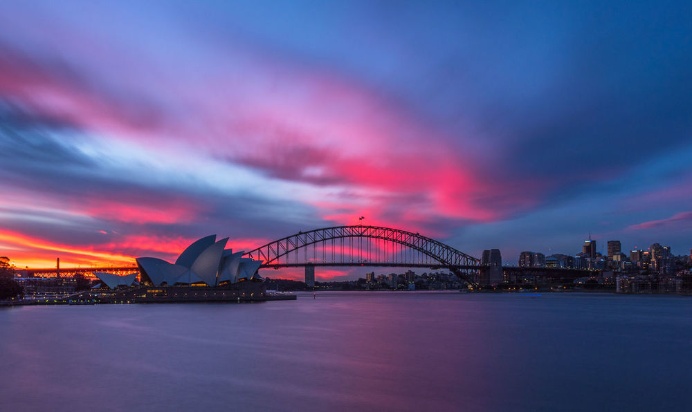 Red sky over Sydney city Architecture Bridge - Man Made Structure Building Exterior Built Structure City Cityscape Cloud - Sky Dusk Illuminated Long Exposure Nature Night No People Outdoors Red Sky Scenics Sea Sky Skyscraper Sunset Sydney Travel Destinations Urban Skyline Water Waterfront