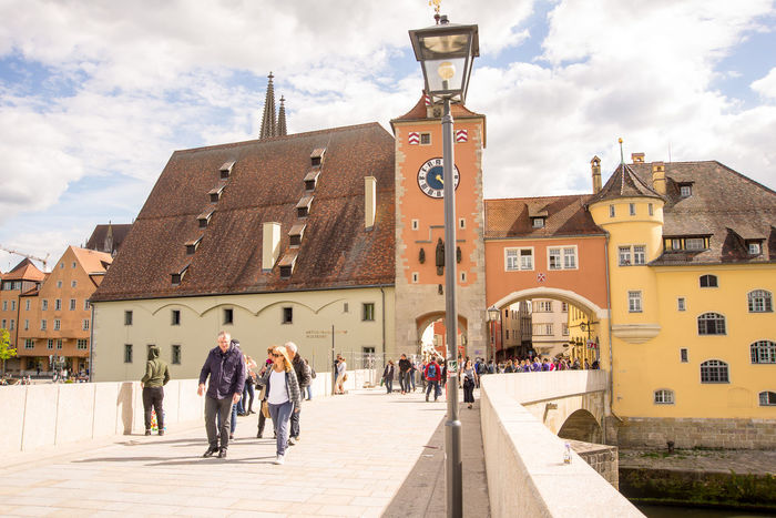 People walk on the Stone Bridge Architecture Building Exterior Built Structure City Cloud - Sky Day Men Outdoors People Real People Regensburg/Bavaria  Sky Stone Bridge Sunlight Tourism