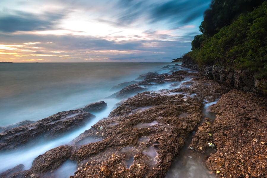 Long exposure shot on the beach. Long exposure shot at Yin Yom Beach, Chonburi, Thailand. Cloud Rock Sky And Clouds Beach Beachphotography Cliff Cloud - Sky Graceful Landsacpe Longexposure Nature Ocean Rock - Object Scenics Sea Seascape Sky Smoothie Sunset Tender Water Wave
