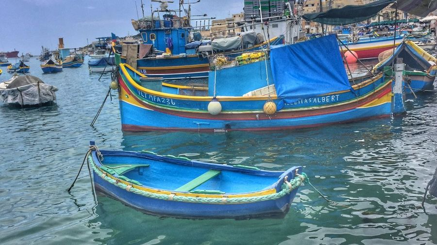 Colorful boats in harbour at Marsaxlokk, Malta Architecture Boat Building Exterior Built Structure Day Gondola - Traditional Boat Harbor Mode Of Transport Moored Nature Nautical Vessel No People Outdoors Sky Transportation Water Waterfront