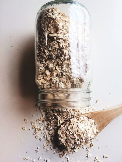Jar of oats Food And Drink No People Healthy Eating Food Table Breakfast Close-up Indoors  Raw Ingredients Spill Oats Oatmeal Cooking Ingredient Wooden Spoon Spilled Spilled Oats Mess Hearty Ingredients Jar Flatlay Flat Lay Food Flat Lays
