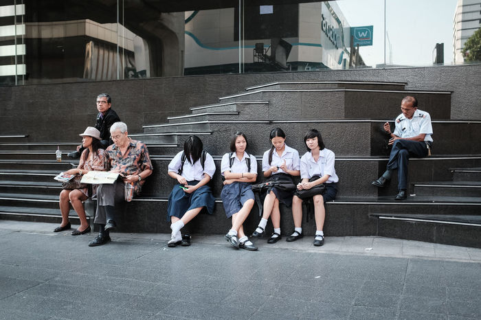 A street scene near Siam Center shopping mall, Bangkok, Thailand Bangkok Day Friendship Full Length Horizontal Junior High Mature Men Medium Group Of People Men Outdoors People Shopping Mall Siam Centre Siam Square Sitting Stairs Street Photography Streetphoto Streetphotography Student Thailand Togetherness Uniform Young Adult Young Women