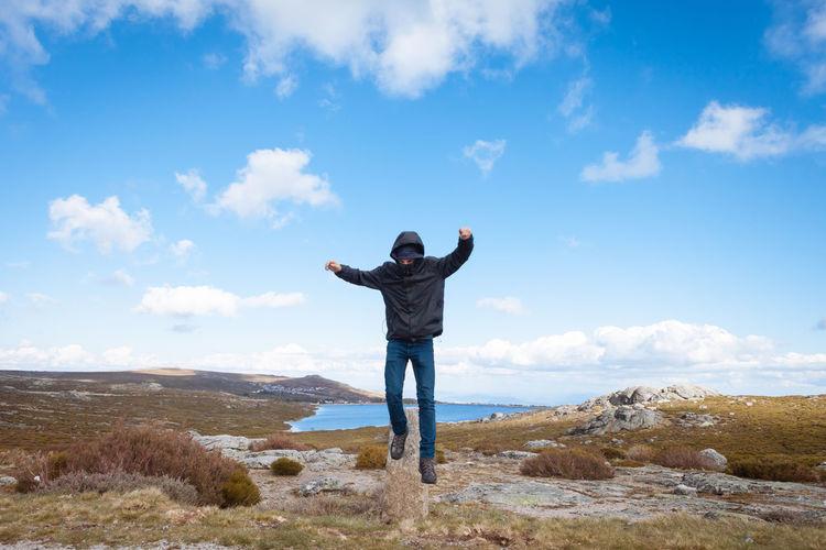 Full length of man standing against sky