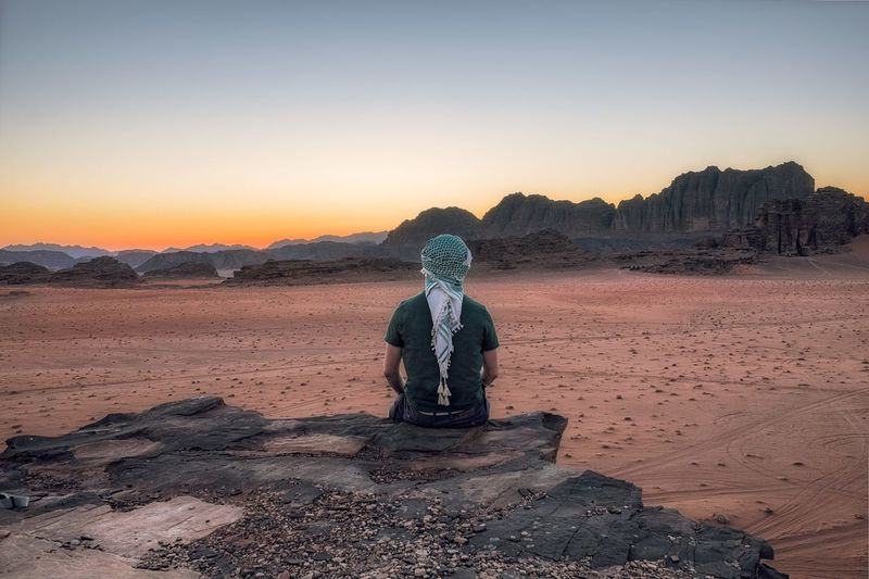 Sunset in Wadi Rum, Jordan. Bedouin Desert Jordan Matthias Church Nature Travel UNESCO World Heritage Site Beauty In Nature Day Dengler Desert Full Length Landscape Nature Nature_collection One Person Outdoors People Real People Sand Scenics Sky Snapshopped Sunrise Sunset