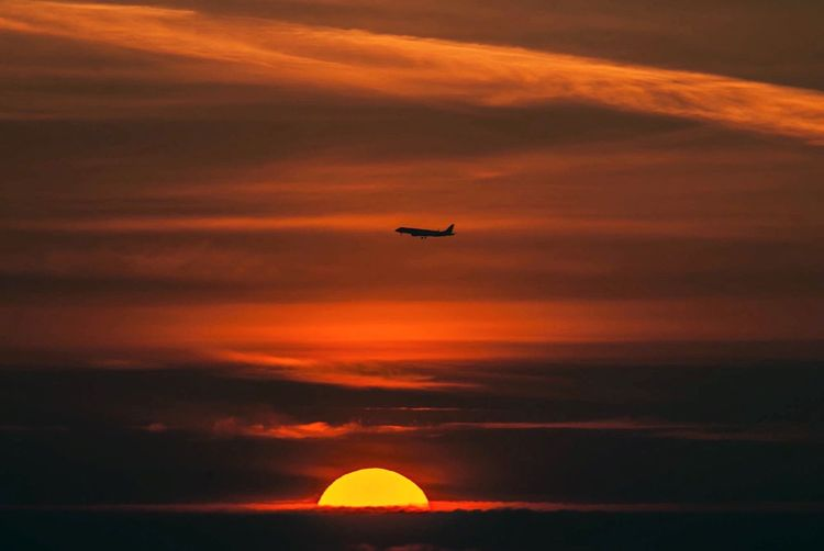 Sunrise with landing Sunset Orange Color Sky Flying Cloud - Sky Beauty In Nature Scenics - Nature Transportation Airplane Air Vehicle Idyllic Silhouette Tranquility Nature Tranquil Scene