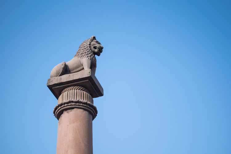 Pillars of Ashoka Low Angle View Sky Blue Clear Sky Architecture Copy Space Art And Craft Built Structure Sculpture Representation No People Day Architectural Column Nature History Building Exterior The Past Statue Creativity Animal