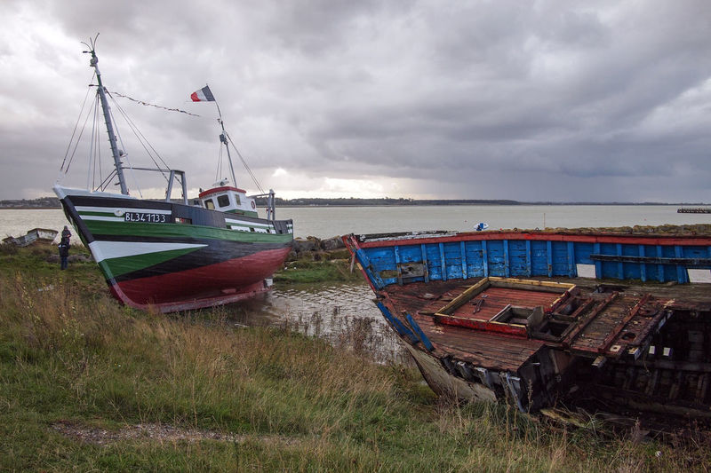 Dark Clouds Dark Sky France Le Crotoy Boat Boats Dark Weather Day Fisherboats  Grass Grey Grey Clouds Horizon Over Water Mast Nautical Vessel No People Old Old Boats Outdoors Scenics Sea Sky Somme Tranquility Water