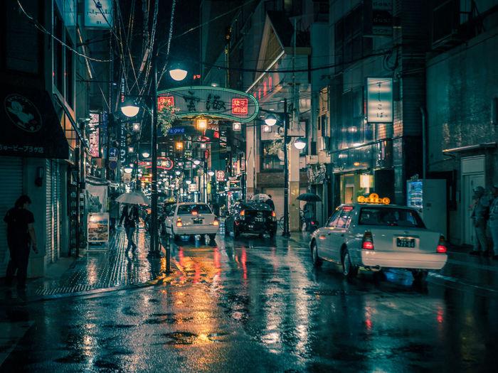 Hiroshima Cinematic Cinematic Photography Japan Japan Photography Nightphotography Architecture Building Exterior Built Structure Car City City Life Hiroshima Illuminated Night Outdoors People Street Streetphotography Wet
