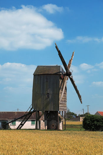 Traditional wooden windmill in France in the Eure &Loir Valley region. Sky Field Land Cloud - Sky Environment Architecture Landscape Built Structure Rural Scene Fuel And Power Generation Turbine Wind Turbine Renewable Energy Agriculture Wind Power Alternative Energy Farm Nature Windmill Wooden Windmill Traditional Windmill French Windmills Traditional French Windmill Eure Et Loir Saint-Thomas Mill