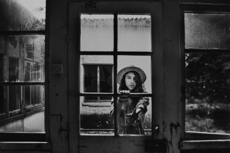 Portrait of building seen through glass window