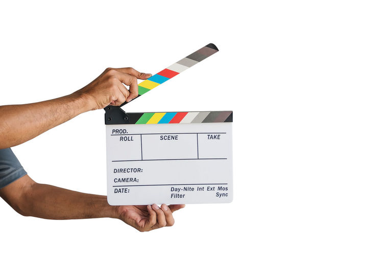 Hand holding a film clapboard slate or movie slate isolated on white background. Backgrounds Clapperboard Movies Holding Hand Slate Board Industry Action Isolated Object Director Cinema Production Entertainment Event Shot Sign Motion Equipment Photography Video Acting Star Hollywood Symbol