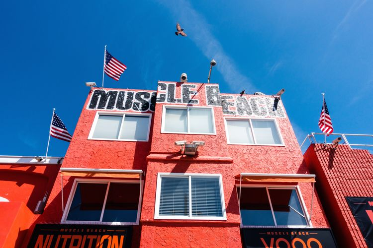 Building Exterior Architecture Built Structure Window Patriotism Building Flag Low Angle View No People Day Red Sky Blue Nature Pride Sunlight Residential District Outdoors Independence National Icon Muscle Beach