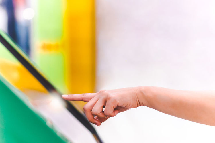 Close-up of hand holding yellow flower in playground