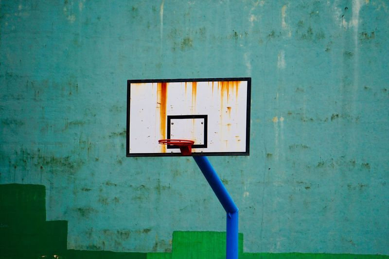 Old basketball hoop in the street
