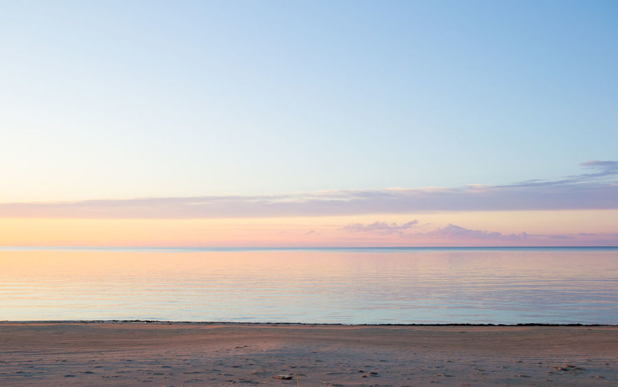 Baltic Sea Beach Beauty In Nature Blue Calm Cloud Cloud - Sky Coastline Horizon Over Water Idyllic Lativia Nature No People Non-urban Scene Orange Outdoors Pink Remote Scenics Seascape Sky Sunset Tranquil Scene Tranquility Water