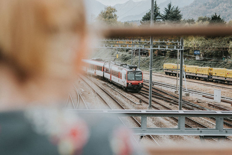 Watching Trains Commuter Train Land Vehicle Mode Of Transport Outdoors Public Transportation Rail Transportation Railroad Track Real People Swiss Train Train - Vehicle Transportation Travel