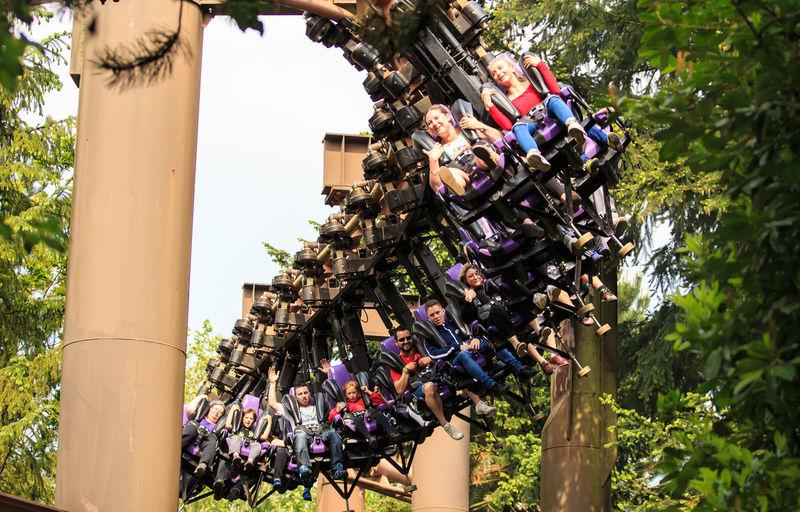 People enjoying a roller coaster ride in a theme park in the UK Adrenaline Junkie Chessington Chessington World Of Adventures England Fun Joy Ride Need For Speed Roller Coaster Rollercoaster Speed Theme Park Uk