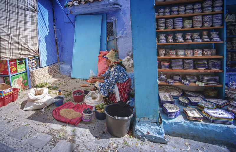 """""""The Blue City"""" - A day in the market life Chefchaouen Chefchaouen Medina Chefchaouen Blue City Morocco Travel Destinations Travel Travel Photography Digital Nomad Tourism Tourist Attraction  Tourist Destination EyeEmNewHere EyeEm Best Shots Architecture Built Structure Choice Day Large Group Of Objects Container Building No People House Outdoors Variation Small Business For Sale Abundance Building Exterior Nature Art And Craft Messy Domestic Room"""