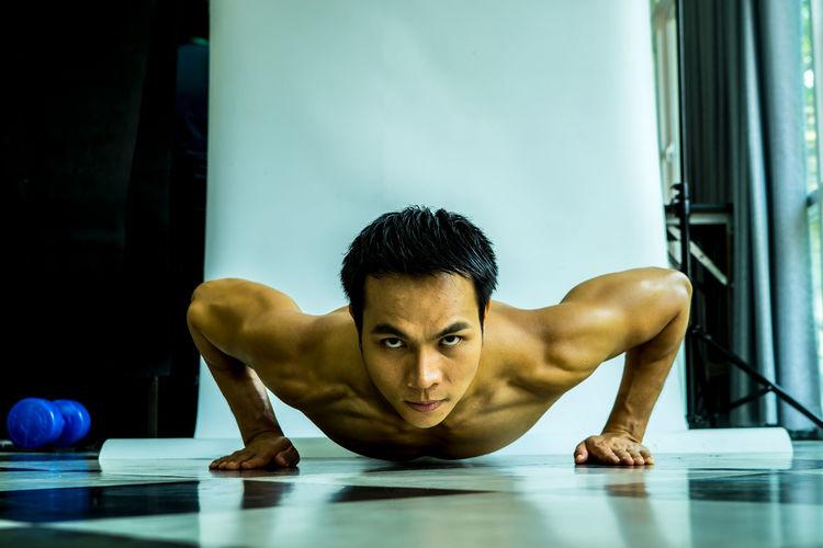 Confident Muscular Man Exercising
