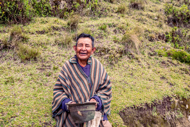 Adult Cheerful Day Ecuador Happiness Hat Holding Indigenous  Looking At Camera Mature Adult Men Nature One Man Only One Person One Senior Man Only Outdoors People Poncho Portrait Real People Senior Adult Senior Men Smiling South America Standing