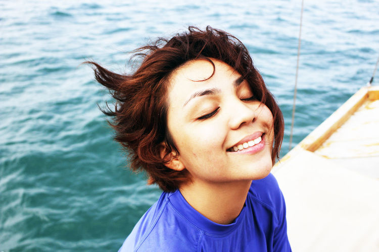 Close-Up Portrait Of Young Woman On Boat