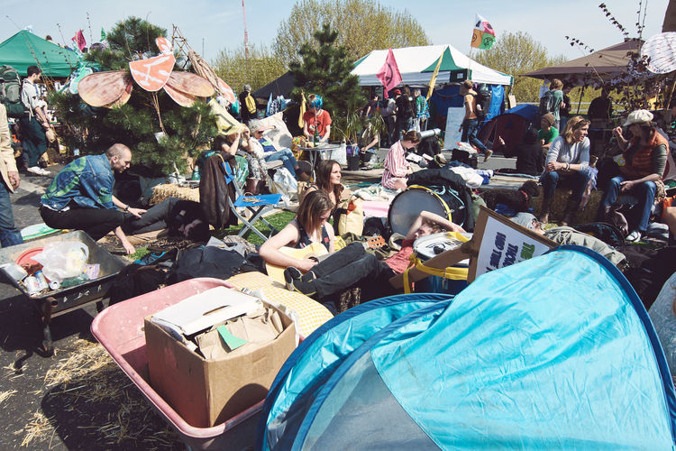 Extinction Rebellion - London 2019 Extinction Rebellion Protest Protesters London Group Of People Crowd Real People Large Group Of People Men Women Lifestyles Day Adult Sitting Leisure Activity Nature Outdoors Market Architecture City Relaxation Built Structure Sunlight