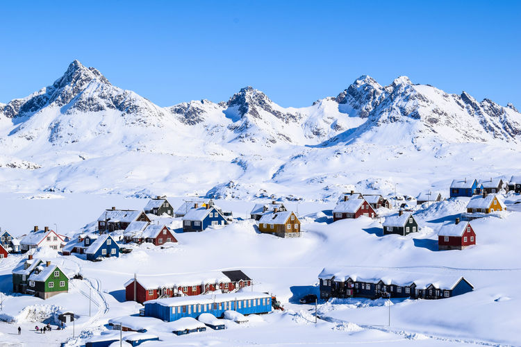 Scenic View Of Snow Covered Houses Against Clear Sky