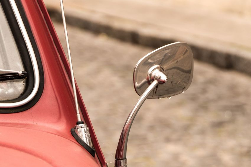 Raindrops on the mirror of a vintage car Streetphotography Vintage Cars Vintage RainDrop EyeEm Selects Focus On Foreground Day Transportation Mode Of Transportation No People Car Motor Vehicle Close-up Land Vehicle High Angle View Outdoors Metal Sunlight Nature Travel Red Vintage Car Side-view Mirror Transportation Retro Styled Red Autumn Mood