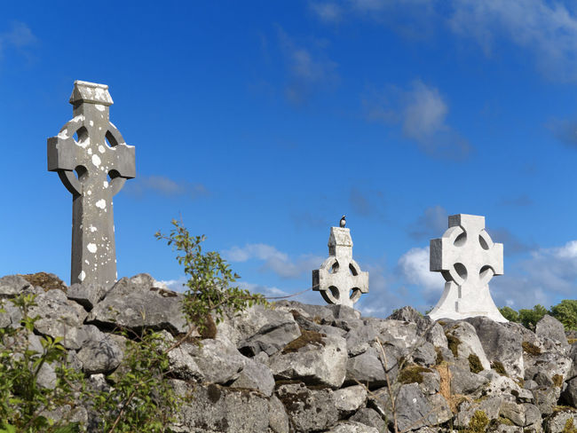 Celtic Cross Co Clare Copyspace Cross Graveyard Ireland Landscape Low Angle View No People Sightseeing Stone Stone - Object Stone Wall The Past Tranquility