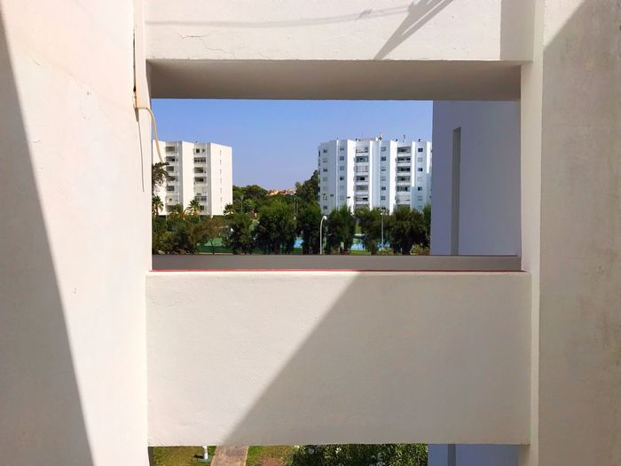 Building frames Light White By The Beach Relax Vacations España SPAIN Shadows Sunlight Frame Neighborhood Architecture Built Structure Building Exterior Window Day Shadow Sky No People Tree Outdoors