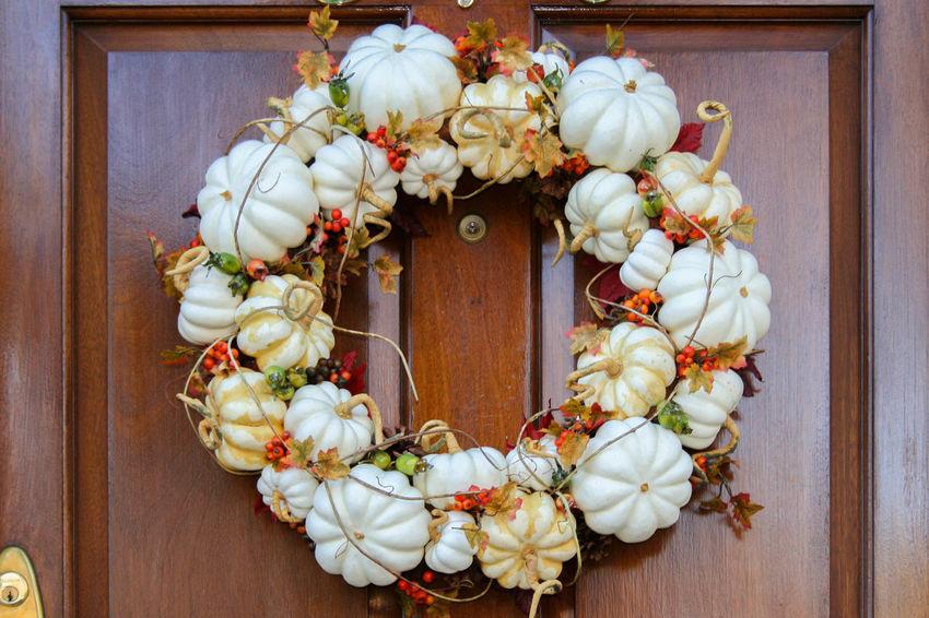 Fall wreath on a dark wood door Autumn Colors Pumpkins Close-up Day Door Fall Flower Gourds Handmade Hanging Indoors  No People White Wreath
