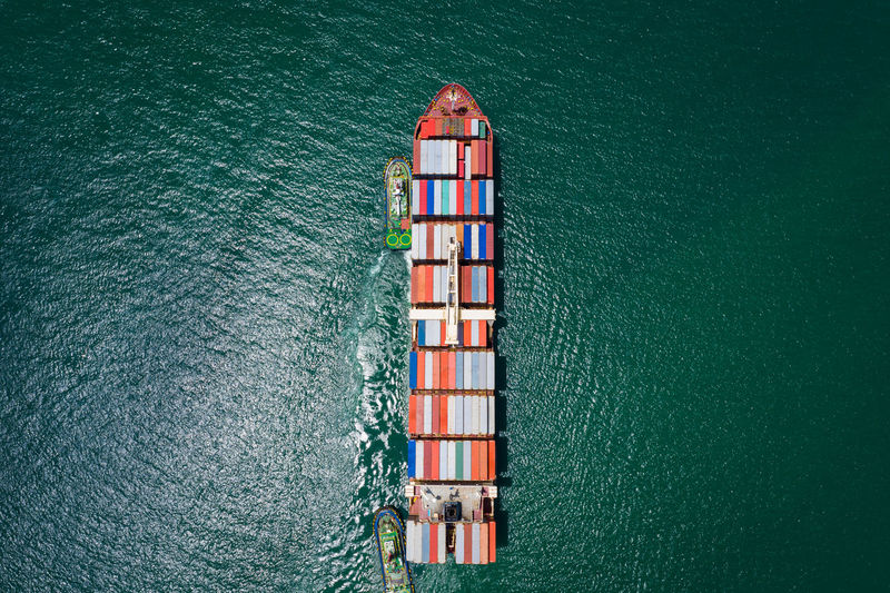 Container ship sailing the ocean, business cargo logistics service and transportation