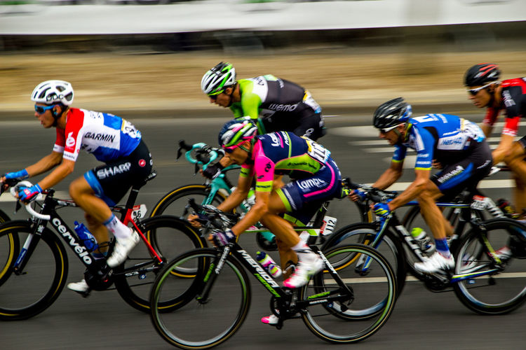 Men Riding Bicycles In Competition