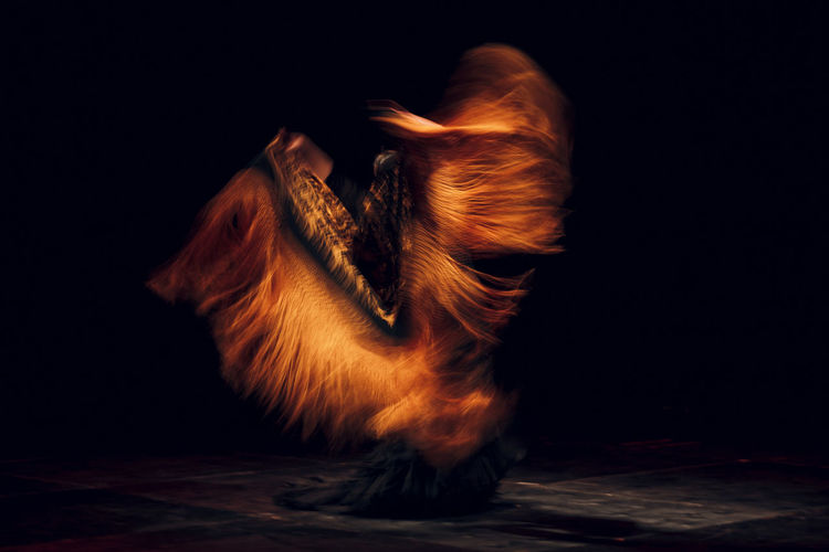 Woman dancing on stage in dark