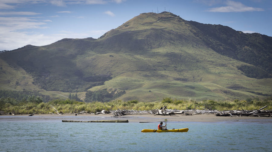 uawa Kayaking Adventure Beauty In Nature Cloud - Sky Day Kayak Leisure Activity Mode Of Transportation Mountain Nature Nautical Vessel New Zealand Non-urban Scene Outdoors Real People Scenics - Nature Sky Tranquil Scene Tranquility Transportation Water Waterfront