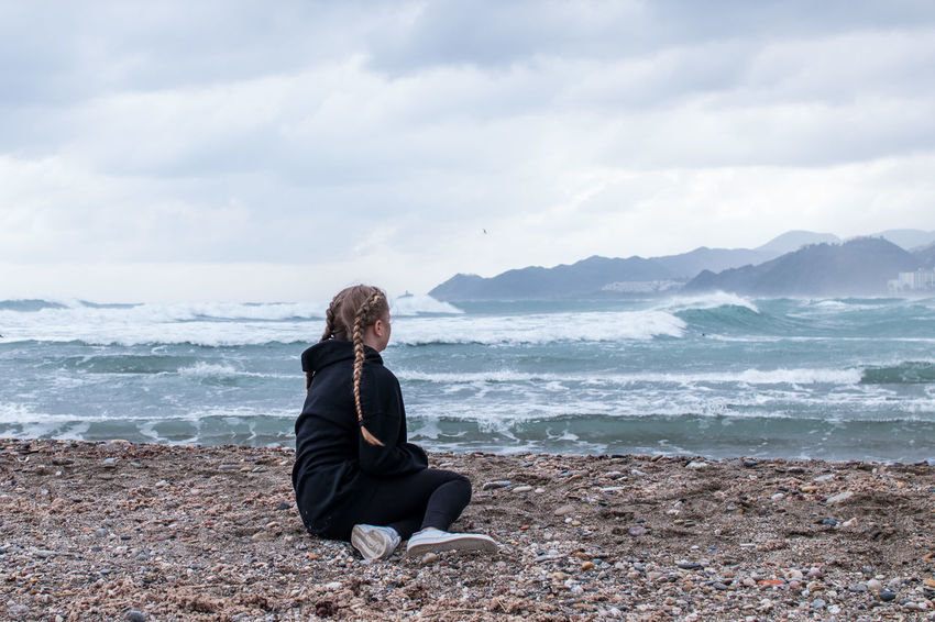 Winter in Spain Winter Adult Beach Blond Hair Day Full Length Horizon Over Water Leisure Activity Mature Adult Nature One Person Outdoors People Portrait Real People Scenics Sea Sitting Sky Streamzoofamily Tranquility Water Wave