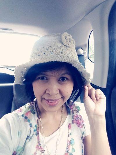 Portrait of smiling girl in car