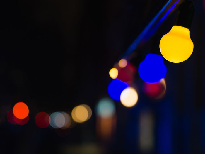 Night Illuminated Lighting Equipment Multi Colored City Defocused No People Light Glowing Circle Light - Natural Phenomenon Shape Geometric Shape Yellow Electric Light Focus On Foreground Street Close-up Outdoors Electricity  Nightlife Lantern Hanging Light Entertainment Capture Tomorrow