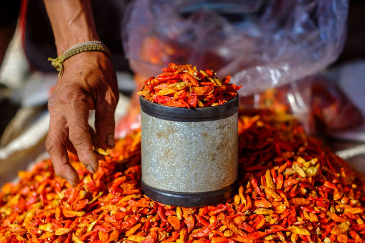 Dried red chili or chilli cayenne pepper. Blur background Food And Drink Food Human Body Part Human Hand Hand Focus On Foreground Spice Day Preparation  Red Cayenne Cayenne Pepper Dry Dried Asian  Cooking Healthy Cuisine Flavoring Ingredients Closeup Color Blurred Background Unrecognizable Person