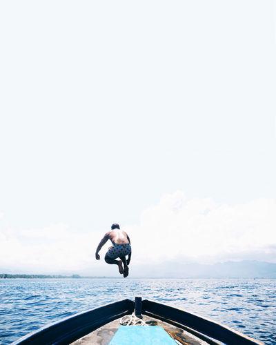 Jump! Adventure Adventures ASIA Blue Boat Eyem Eyem Best Shots Eyemphotography INDONESIA Minimal Minimalism Ocean Olympus Olympus Inspired Olympus Pen-f Olympusinspired Outdoors People Sea Sea And Sky Sky Swim Travel Water