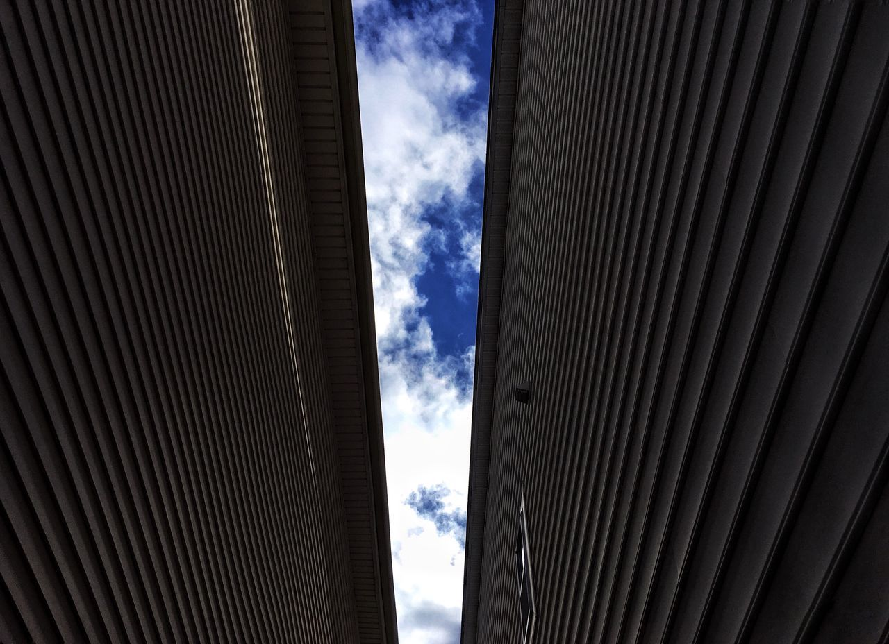 architecture, cloud - sky, built structure, sky, no people, building exterior, backgrounds, day, pattern, low angle view, outdoors, corrugated iron, close-up