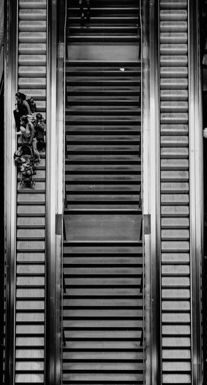 High Angle View Of People On Escalator At Shopping Mall
