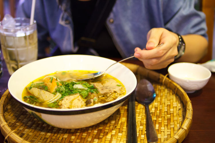 Cropped Image Of Woman Having Pho Soup