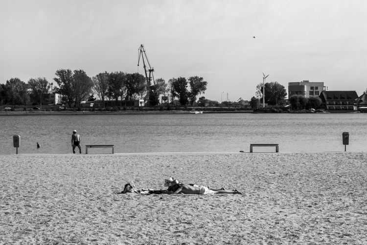 Tanning 1 Beach Blackandwhite Canon Canonphotography Casual Day Helicopter Lake View Leisure Activity Nature Playing Sand Sand Dune Sky Tanning Togetherness Tranquil Scene Tranquility Wildlife The Street Photographer - 2017 EyeEm Awards