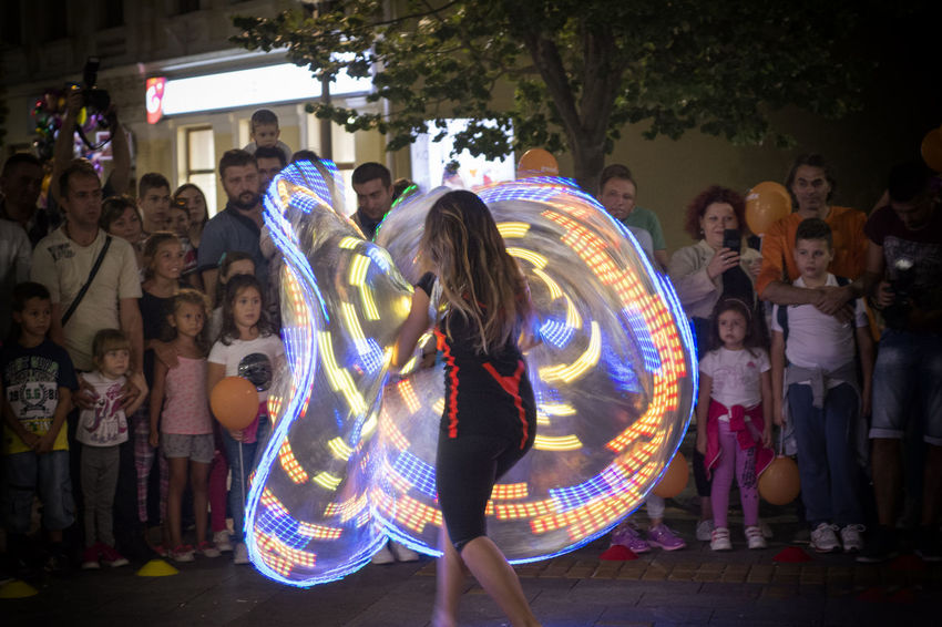 Lighting butterfly Multi Colored Performance Artist Arts Culture And Entertainment Women Skill  Theatrical Performance Street Art Light Painting
