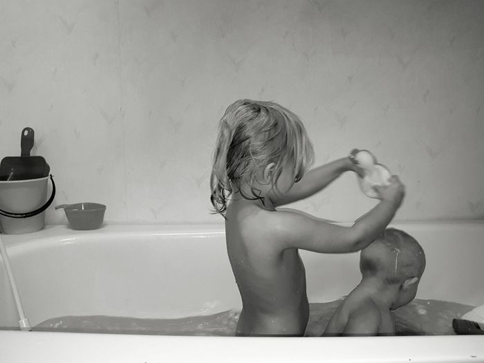 Taking A Bath Water Domestic Bathroom Bathtub Washing Bathroom Domestic Room Domestic Life Kids Playing Black & White Black And White Blackandwhite Blackandwhite Photography Human Body Part Day Indoors  Happiness Baby Childhood Toddler  Family Cute Enjoy The New Normal Body Care BYOPaper! This Is Family 50 Ways Of Seeing: Gratitude Moments Of Happiness #NotYourCliche Love Letter My Best Photo